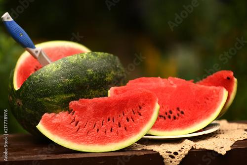 Cut Ripe Big Water Melon Still Life With Knife On Green Garden