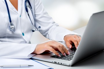 Doctor at hospital working with laptop