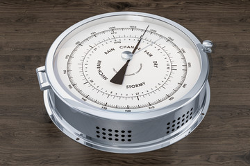 Barometer closeup on the wooden background , 3D rendering