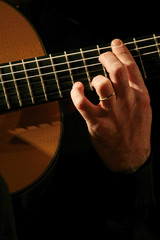 Man playing acoustic guitar close-up performance
