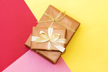 two rectangle gift box on three color paper : red, yellow and pink