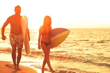 Young Couple going surf on beach