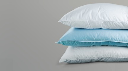 Soft Pillows Pile on grey background, three