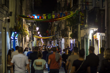 LISBON, PORTUGAL - JUNE 21, 2018: People on street during popular saints festival