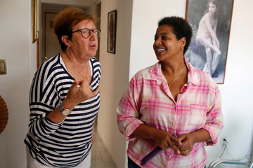 Cuban same-sex couple Mercedes Garcia and Onelia Miranda, who have been together for ten years, talk at their apartment in Havana