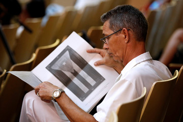 Cuban reads the draft proposal of changes to the constitution during the beginning of a public political discussion to revamp a Cold War-era constitution in Havana