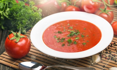 Fresh tomato soup on desk