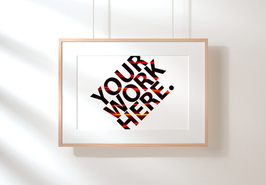 Horizontal Frame Mockup Hanging on Wall