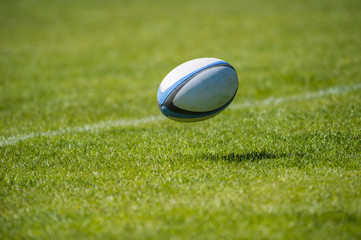 rugby ball over the grass in the stadium