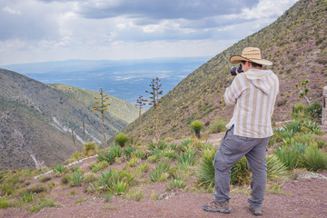 Man shooting a beautiful cactus landscape at Real de Catorce desert in San Luis Potosi, Mexico