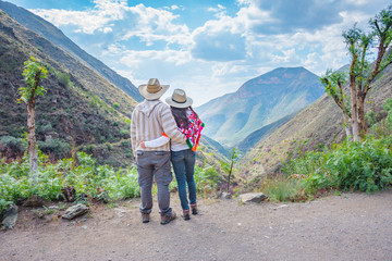 Couple contemplating a beautiful landscape at Real de Catorce desert in San Luis Potosi, Mexico