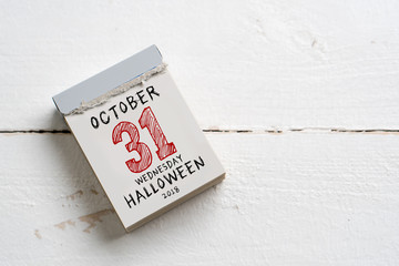 tear off calendar with octover 31st 2018, Halloween on top