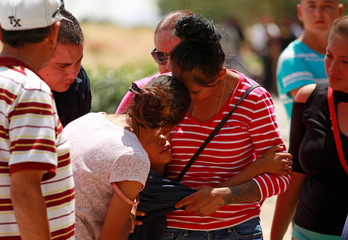 Relatives and friends react near the area where the body of 6-year-old David Rafael Santillan, who according to local media disappeared on August 8 was found dead on August 13 in an empty lot close to his house, in Ciudad Juarez