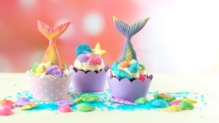 Mermaid theme cupcakes with colorful glitter tails, shells and sea creatures toppers for children's, teen's, novelty birthday and party celebrations.