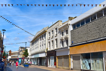 High street with shops and buildings in traditional style. The lively coastal town center of Dover, Kent county, England