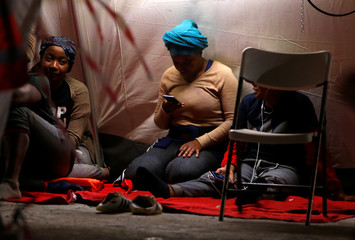 Migrant women are seen in a tent of Spanish Red Cross after arriving on a rescue boat at the port of Malaga