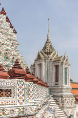 Detail of intricate ceramic wall with chedi and sky as background in Wat Arun. Bangkok, Thailand.
