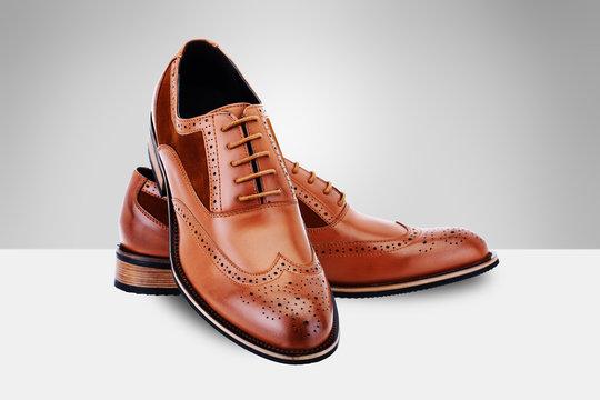 Brown men's shoes on split background