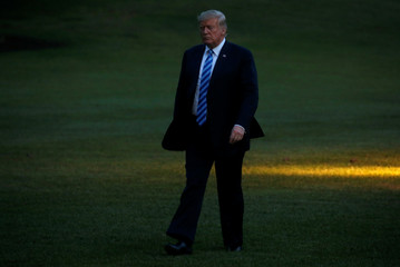 U.S. President Donald Trump walks across the South Lawn after arriving in Marine One from a recent trip to New York at the White House in Washington