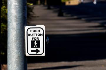 Crosswalk button mechanism on a steel post