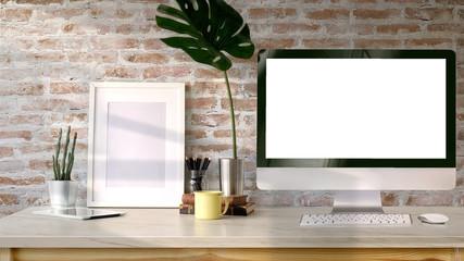 Loft workspace, Blank screen desktop computer and mockup poster on desk.