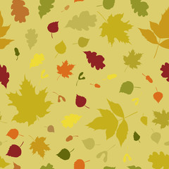 Seamless texture with colorful autumn leaf silhouettes isolated on light background for fabric or wrapping design.