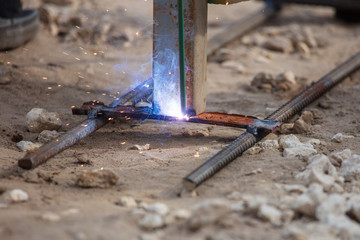 Worker welds metal at the construction site