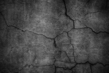 Black cement wall. Dark texture of cracked concrete