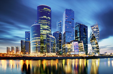 Moscow City skyline . Moscow International Business Centre at night time with Moskva river.
