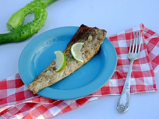 Light lunch or dinner, mackerel fillet cooked on the grill. Served with slices of lime.