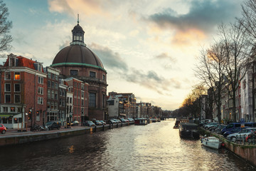 The dome church along the Singel canal in the old center of Amsterdam during sunset