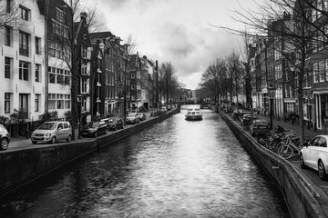 Black and white photo of a canal boat in the Brouwersgracht in the old center of Amsterdam