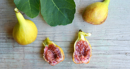 fresh Figs on the table and one sliced
