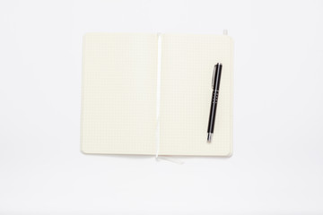 White notebook minimal image on white table