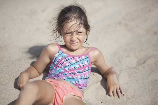 Little girl 6 years old on the beach in Spain near Alicante city