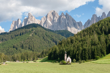 The Church of St. Johann in Ranui, in the Italian Dolomites, on a summer afternoon.