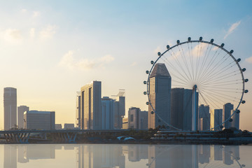 Singapore business district city and building with the Singapore Flyer gian Ferris wheel and the bridge