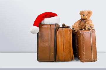 Stack of Old suitcases with teddy bear and santa hat
