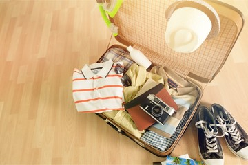 Travel bag on wooden floor