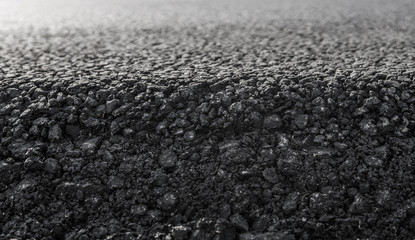 Close-up on a layer of new asphalt at the road under construction.