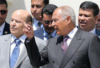 Arab League Secretary-General Ahmed Aboul Gheit (R) speaks with Yemeni President Abd-Rabbu Mansour after their meeting in Cairo