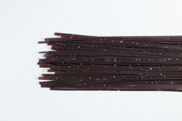 black organic pasta with grain and cereal  . food background