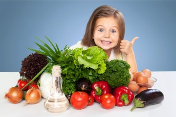 Portrait of adorable little girl preparing healthy food at