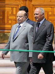 Arab League Secretary-General Ahmed Aboul Gheit (R) walks with Yemeni President Abd-Rabbu Mansour after their meeting in Cairo