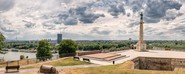 Kalemegdan fortress and Victor monument Belgrade, Usce Sava and Danube confluence view at cloudy spring day, Ada Bridge and Usce Building