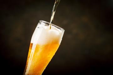 Keuken foto achterwand Bier / Cider A glass of beer on a dark background.