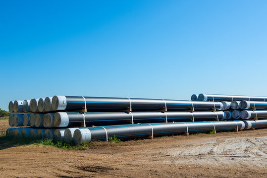 storage place of big plastic pipes for  heating, plimbing, sewage on a building site