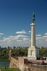 Kalemegdan fortress and Victor monument Belgrade, Usce Sava and Danube confluence view at sunny summer day, blue sky with small white clouds