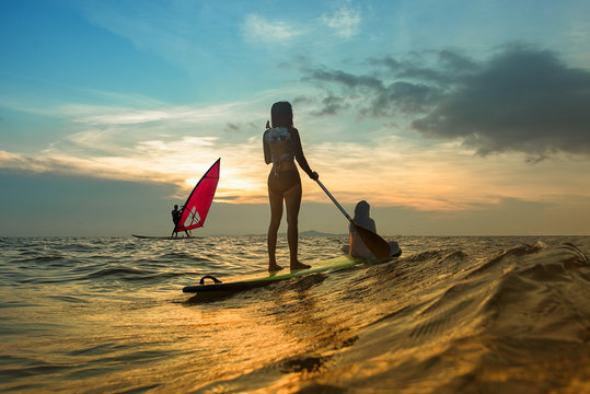 water sport on family join together playing in the sea, surfboard and windsurf for summer time holidays vacation on trip of family enjoy