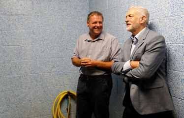Jeremy Corbyn, the leader of Britain's Labour Party, chats with farm manager Scott Kirby during a visit to Harper Adams University in Newport